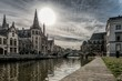 canvas print picture - Cityscape with a lot of buildings reflected in the lake under the breathtaking sky in Ghent Belgium