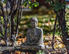 Buddha Statue In Garden In Fall