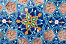 Detail Of Old Mosaic Wall With Traditional Georgian Floral Pattern With Clay And Ceramic Details Of Red, Yellow And Blue Colors