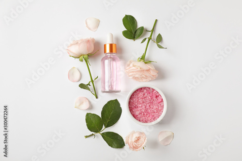 Composition with rose essential oil on white background, top view Wallpaper Mural