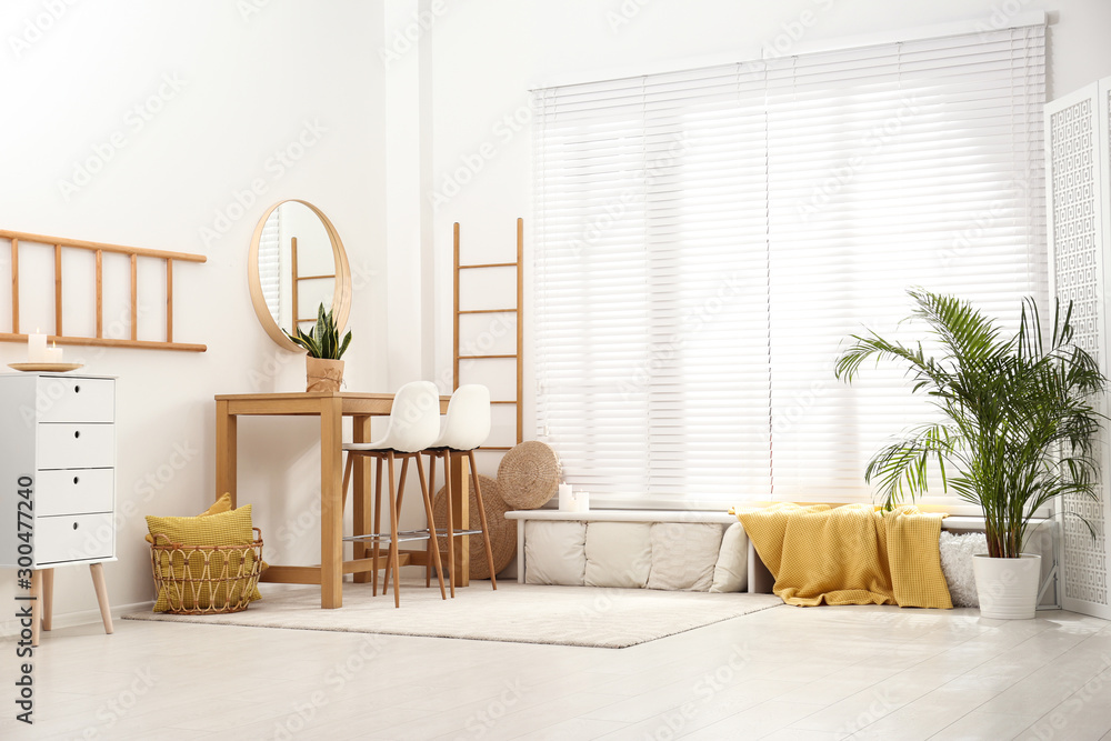 Fototapeta Stylish room interior with wooden table and bar stools
