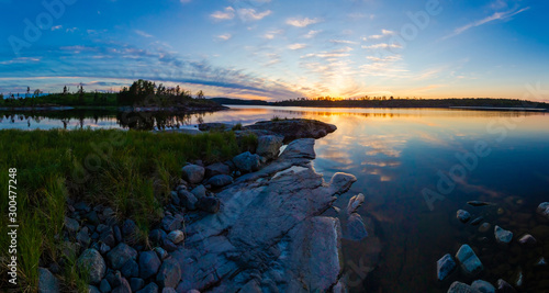 Obraz na plátně Panorama of Karelia at sunset