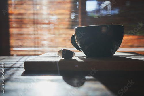 Tuinposter Cafe Cup of coffee cappuccino on the old adged wood table surface