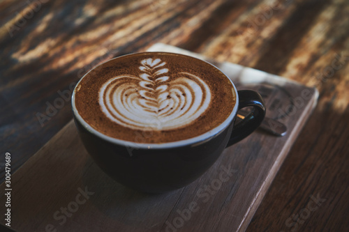 Keuken foto achterwand Cafe Cup of coffee cappuccino on the old adged wood table surface