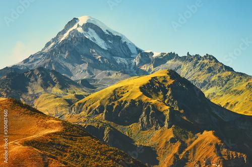 Foto auf AluDibond Blau türkis Panoramic view of Mount Kazbek in the Caucasus Mountains of Georgia is not far from the village of Stepantsminda