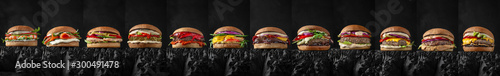 Fototapeta Superset of delicious juicy beef burgers, cheeseburgers, fishburgers made from aged beef cutlets, seafood, sauces. For posters, promotions, menus. Free space for text. obraz