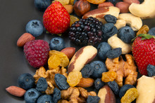 Different Berries And Nuts On ...
