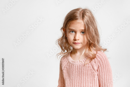 Cute little girl on light background Wallpaper Mural