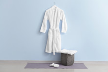 Clean Bathrobe Hanging On Wall...