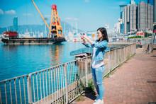 Girl Traveling In Hong Kong Causeway Bay Waterfront.