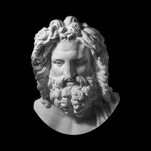Gypsum Copy Of Antique Statue Zeus Head Isolated On Black Background. Plaster Sculpture Man Face With Beard.
