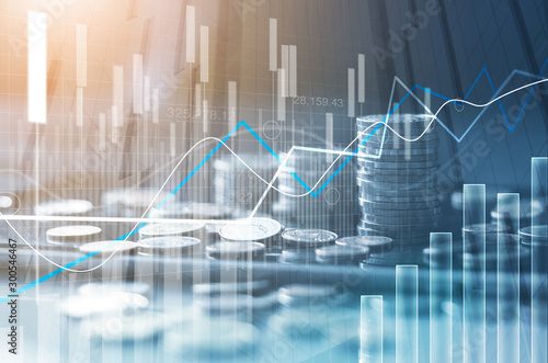 Fototapeta Financial stock market graph and rows of coins growth, abstract and symbol for finance concept, business investment and currency exchange, on blue background. obraz