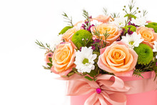 Beautiful Bouquet In A Coral Luxury Present Box With A Pink Bow, Isolated On White Background