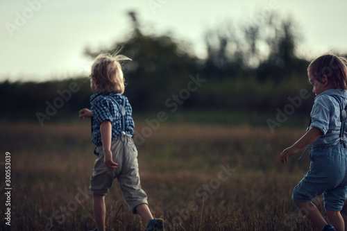 Staande foto Artist KB Portrait of cheerful brothers playing on a corn field