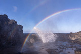 Fototapeta Tęcza - Double rainbow over Nakalele blowhole. Sunrays reflect on a spray coming from a blowhole creating beautiful color stripes