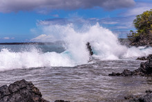 Huge Wave Splashes On A Rocky Beach. A Large Lava Rock Completely Covered In A White Ocean Spray, La Perouse Bay, Maui,, Hawaii