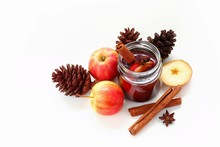 Autumn Sangria Drinking With Apple And Cinnamon, Brown Leaves, Pinecone, White Background, Thanksgiving Or Halloween And Christmas Beverage For Party, Copy Space
