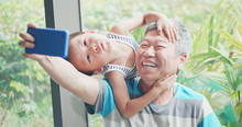 Grandfather Take Selfie With Kid