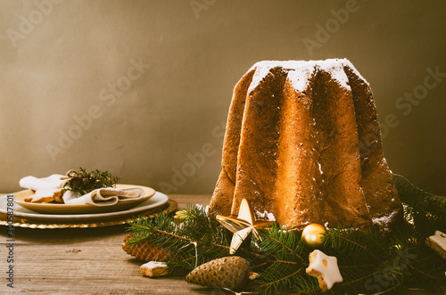Cuadros en Lienzo Pandoro -typical Italian christmas sweet yeast bread on old rustic wooden table