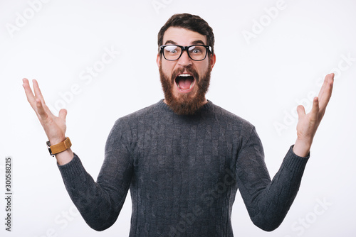 Photo of young amazed man gesturing over white background Canvas-taulu