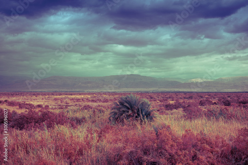 Montage in der Fensternische Hochrote Nature landscape. Desert with dramatic sky. Arava desert. View of the valley with mountains on backdrop. Nature Israel