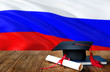 canvas print picture - Russia education concept. Graduation cap and diploma on wooden table, national flag background. Succesful student.