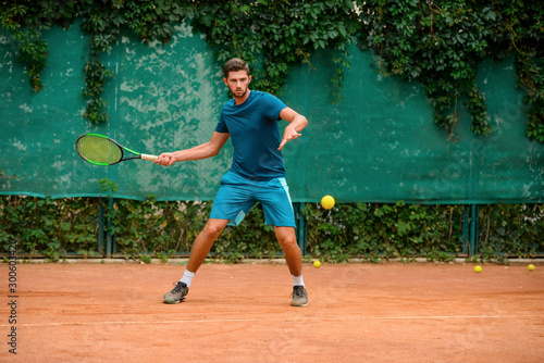 Skilled and agile tennis player having a practice at outdoor court Canvas Print