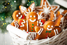 Handmade Festive Gingerbread Cookies In The Form Of Stars, Snowflakes, People For Christmas And New Year Holiday On A White Wooden Table.