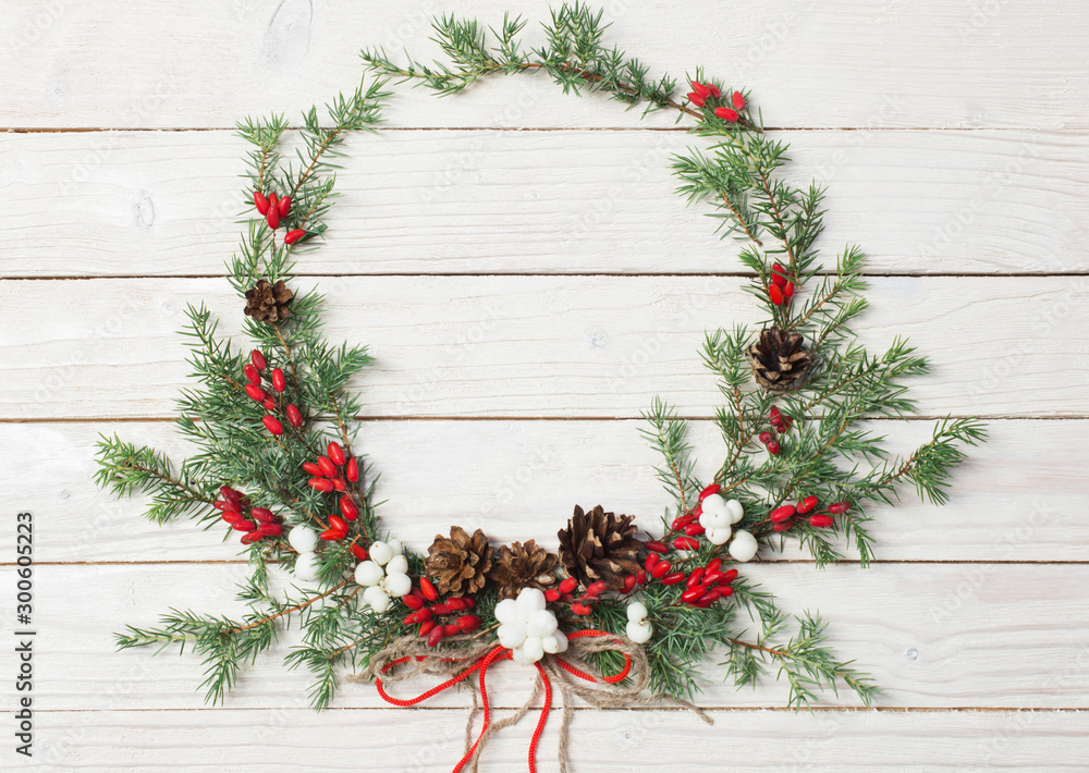 Fototapety, obrazy: Christmas wreath on white wooden backdrop
