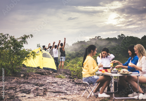 Group of best friends with hands raise up and looking beautiful view feeling happy and smiling together at rain forest,Back view #300608697