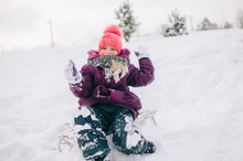 Little Girl Covered In Snow Si...