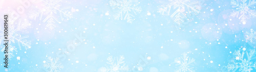 snowflakes and ice crystals isolated on blue sky - winter background panorama banner long