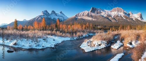 Foto op Plexiglas Zalm Sunrise of the Three Sisters and the Bow River from Canmore near Banff National Park. First snow in Canadian Rockies. Beautiful landscape background concept. Christmas time