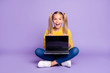canvas print picture - Full size photo of amazed excited child show laptop show touch screen scream wow omg sit crossed folded legs wear casual style outfit isolated over violet color background