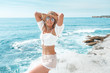Leinwanddruck Bild - Vivacious suntanned woman in shorts and crop top by ocean