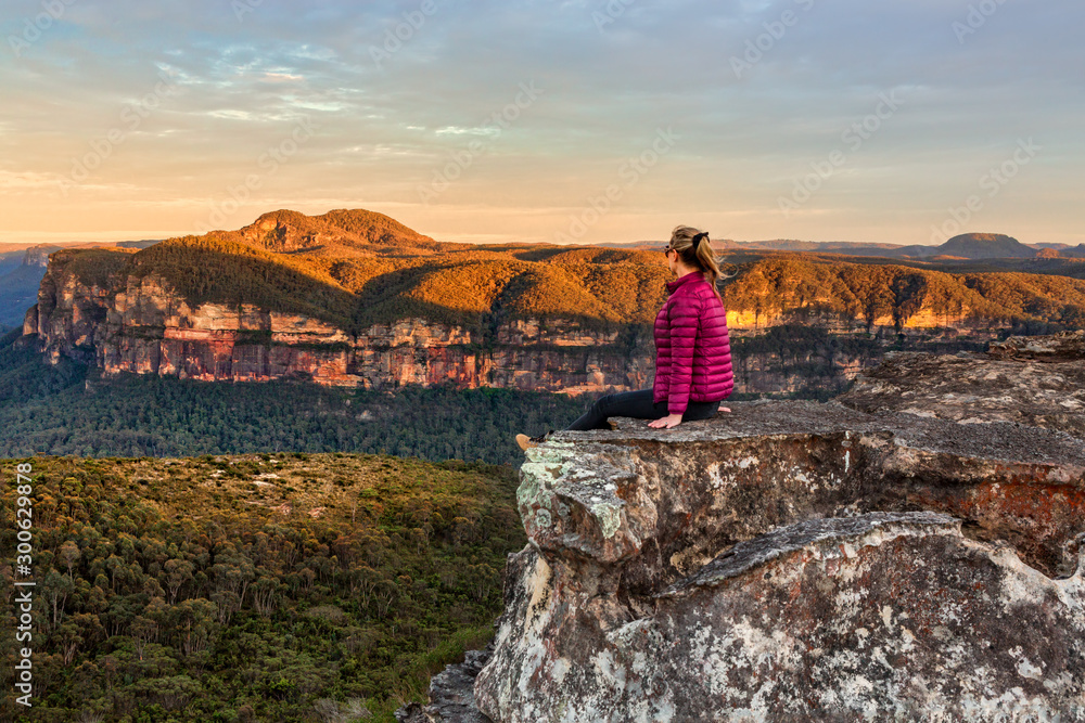 Fototapety, obrazy: Woman taking in early morning mountain views