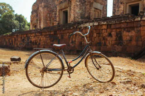 Classic vintage Bicycle in Angkor Wat temple Cambodia © Vivid Cafe