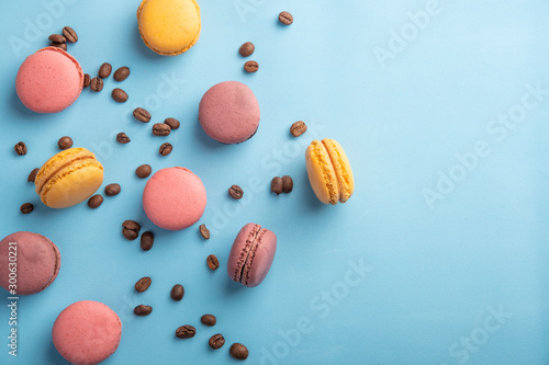 Foto auf Leinwand Macarons Colorful French or Italian macaron stack on blue table with copy space for background. Top view