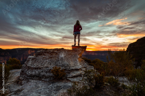 Female hiker taking in heavenly views of mountains and valleys Canvas Print
