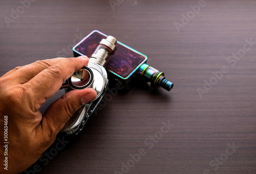 Photo Conceptual image of uncertainty of health safety of e-cigarettes