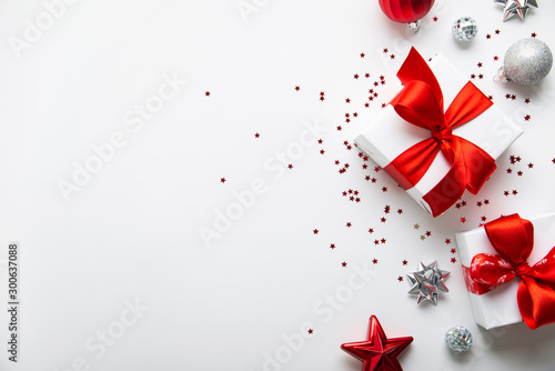 Spoed Fotobehang Kerstmis Christmas and New Year holiday background. Xmas greeting card. Christmas red ribbon gifts and ornaments on white background top view. Flat lay