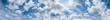Leinwandbild Motiv Blue sky with clouds (wide background panorama).