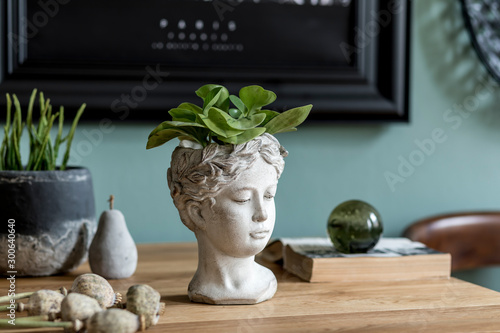 Fotografía Stylish composition of interior design with modern cement sculpture pot, plants, book and elegant decoration on the wooden table