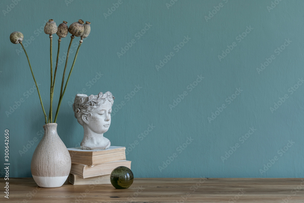 Fototapety, obrazy: Stylish and design composition of home decor on living room with flowers in vase, books, sculpture and wooden table. Modern decoration. Eucalyptus color concept. Template.  Copy space.