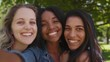 Smiling african american young woman calling her diverse friends for a selfie in the park on a sunny day - smiling happy friends