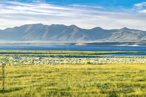 Picturesque Golden Fields and Lake at Sunset: Lake Crowley and the Sierra Nevada Wallpaper Mural