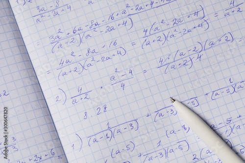 Algebraic calculations in open graph notebook with white pen Canvas Print