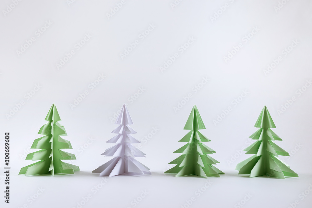 Fototapety, obrazy: Christmas concept. Origami paper green Christmas trees.