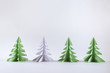 Christmas concept. Origami paper green Christmas trees.