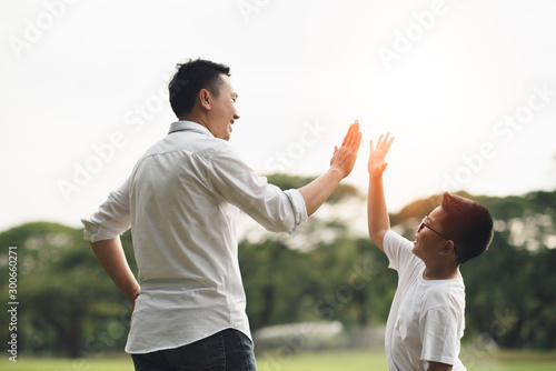 Fotografie, Tablou  happy family running in the park, family asian group relation quality healthy support, home park